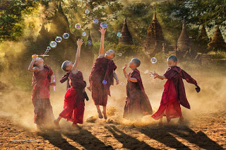 monks with bubbles